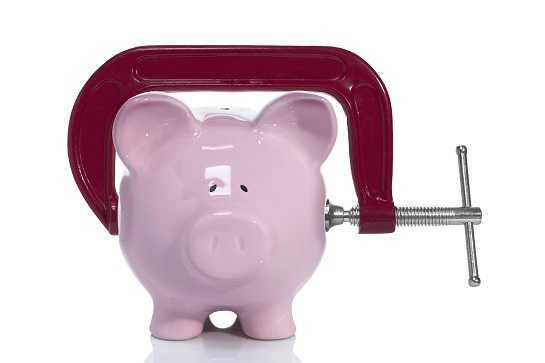 Tight on savings, c-clamp on piggybank